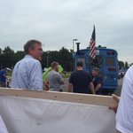 The @JebBush campaign has prime NH parade real estate behind the Bernie Sanders bus that has live chickens on board. http://t.co/hjsj9hBdCA