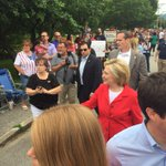 While Clinton marches in Gorham, she is literally being followed by a Benghazi sign. http://t.co/yAIwqy4IVj