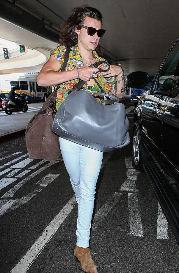 .@Harry_Styles was spotted arriving at LAX yesterday in our custom white skinnies. #LIVEINIT http://t.co/s76Hxp1KPf