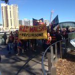 Hundreds of crows fans marching in silence across Adelaide Oval foot bridge. #RIPPhilWalsh #9news http://t.co/UyivD3NTvr