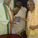 Receiving a book onKrishna from Bhakti VinodaSwami of ISKCON inTvm, who invited me2a conference on environment&ethics