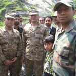 Indian Army hands over a boy from PoK, who inadvertently crossed the LoC to Pak Army officials Pics courtesy: MoD http://t.co/XAY7GRp1LM