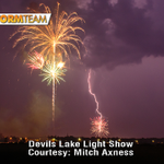 Lightning & fireworks meet in an incredible shot as a storm crashed #4thofJuly event in Devils Lake, ND #VNLStormTeam http://t.co/g2DkgGy7A4