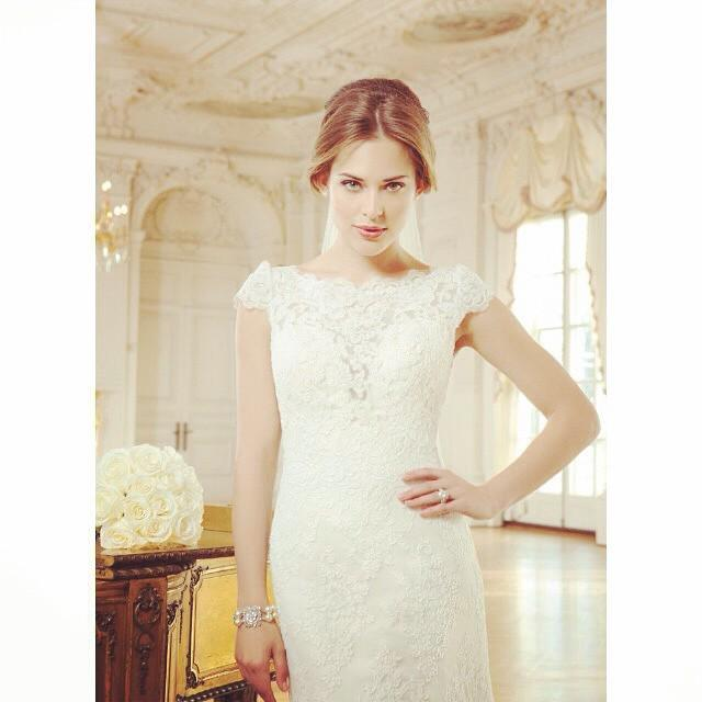 We love the beautiful #lace neckline of this Lillian West #wedding gown.  Style number 6345  Call 08451309966 to vi… http://t.co/bqm2iCJTKz