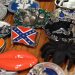 Calgary Stampede asks vendors to stop selling belt buckles, licence plates w/ Confederate flag http://t.co/2EICUjljk1 http://t.co/C9xiKzON8W
