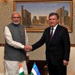 The meetings begin instantly...PM @narendramodi meets PM Shavkat Miromonovich Mirziyoyev after landing at Tashkent. http://t.co/RVJfNJmwQQ