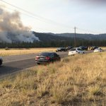 At least 15 cars parked on side of road looking at and taking pictures of the fire #kxly http://t.co/j1x9u6okiX