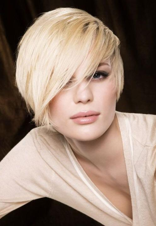 Side swept bangs are a hot #hair trend this summer! This look also adds a more feminine touch to short cuts.#HairTip http://t.co/P5TO2hqMcA