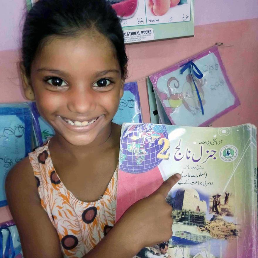 Marriam, grade 2, w/her favorite book at a BRAC Primary school in Karachi, Pakistan #booksnotbullets @MalalaFund http://t.co/rInERg2hkB