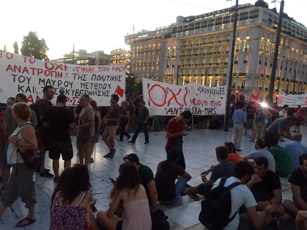 """Happening now, Athens #Greece. Protestors who still say """"Oxi"""" or """"No"""" to the deal on the table. Many favor #Grexit. http://t.co/wsoGcdJ7tX"""
