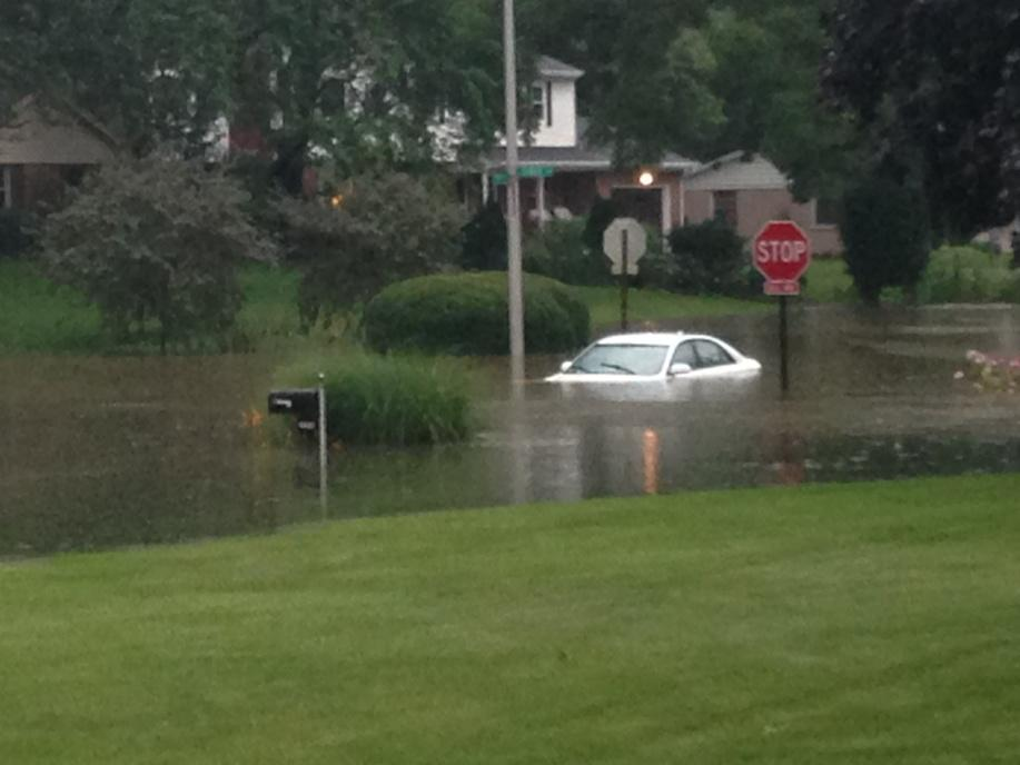 We walked outside after the downpour and saw this. We're near 77th/Allisonville. Water still rising now! http://t.co/030IoeQ4RS