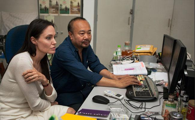 Photo of @AngelinaJP1975 and @RPanh working on her next film project. Source: http://t.co/ssFequh2KO http://t.co/4JRa05iHXp