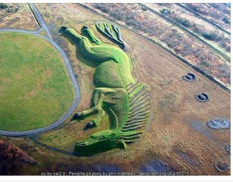 UK's largest earth sculpture was built on a reclaimed coal mine in Wales with mine wastes: http://t.co/w0QjA2hkzp http://t.co/rTKFFjiX05