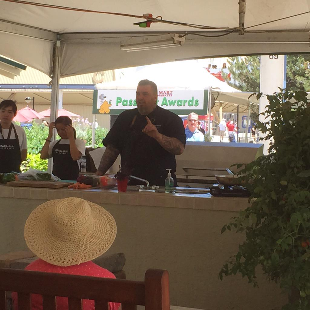.@CulinerdyK Chef Breedlove doing An awesome demo today @CAStateFair making spring rolls! @CulinerdyCruzer http://t.co/ZFMkmcdNKK