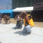 MMDA Chair Francis Tolentino and Phivolcs Dir. Renat Solidum performs duck, cover and hold http://t.co/7FblW4wQe4