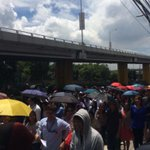 Umbrellas up. One thing worse than a quake is the harsh midday sun #MMQuakeDrill http://t.co/XNYHBhlCjG   @miguelrcamusINQ #MMShakeDrill