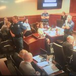 "Woman who screamed ""dont kill him"" in court being detained. Court will decide next step. #theatershooting http://t.co/uSaeySDlTm"