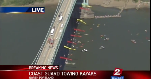 So cool! MT @collinrees: Coast Guard is towing away kayaks, but more canoes & kayaks launching. Amazing. #ShellNo http://t.co/AxU9STccDz