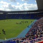 PHOTO: Fans sitting in the sun in the West Stand watching the team warm up. #MyTownMyClub http://t.co/QSm0OTcsob
