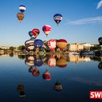 Balloons are reflected at Bristol Harbourside at the launch of @bristolballoon fiesta @SWNS http://t.co/Nq5m0yjY9i