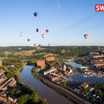 Hot air balloons fly over bristol on a gorgeous morning for @bristolballoon fiesta @SWNS http://t.co/7gi93mg3D0