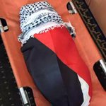 The body of 18 m.o, wrapped in the #Palestinian flag & Kuffi, was burned to death by #Israeli settlers. #حرقوا_الرضيع http://t.co/7JryCtbe1f