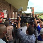 Head coach @FalconsDQ is in there somewhere, speaking to the media #RiseUp http://t.co/Mxq5OJsz6w