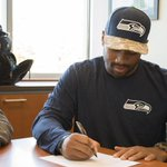 Done deal: Russell Wilson signs a four-year contract extension with the #Seahawks http://t.co/zhjaJXQLmD http://t.co/HKt6SxmVxZ