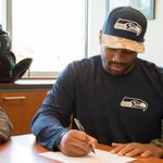 #Seahawks sign @DangeRussWilson to four-year contract extension: [http://t.co/Y09YEu1dBb] #GoHawks http://t.co/WaSeh6jXVx