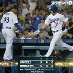 That's a wrap! Zack Greinke tosses another gem as the #Dodgers topple the Angels 5-3 in their opener. #WeLoveIt http://t.co/9DiZPHaYss