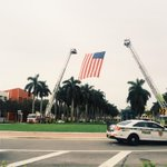 Fire trucks raise a flag at the FIU entrance for fallen and former police director Robert Parker Sr. @MiamiHerald http://t.co/3WFWLrVhzv
