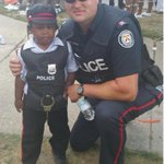 Our CRU officers helped out with the #Caribana parade today. PC Scott Shepheard is seen here w/ our newest officer! http://t.co/z4EPzTdohm