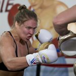 Rousey beats Correia in 34 seconds, retains bantamweight title http://t.co/ZZzffgTSzv http://t.co/dug5kPkSz7