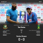 Mushfiqur Rahim and Hashim Amla share Test series trophy after the 2nd Test comes to end a rain-washed draw. #BANvSA http://t.co/t5mDF5GVeo