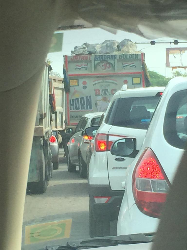 Trucks laden with huge rocks precariously balanced at 9 am on Gurgaon Faridabad Road @TrafflineDEL @GurgaonPolice1 http://t.co/LHEVkAWDZj