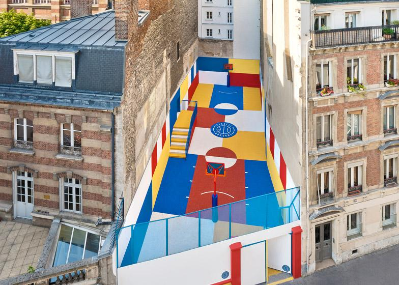 IllStudio has collaborated with Pigalle to create a multicolored basketball court between a row of buildings in Paris http://t.co/YCWR2nzBn6