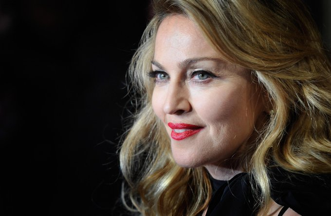 """Happy 57th Birthday, Madonna! See photos of the \""""Queen of Pop\"""" through the years."""