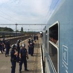 All Europeans taken off train. Refugees realising theyre not going to Austria. Riot police stop anyone getting off. http://t.co/i1tHiq5mRv