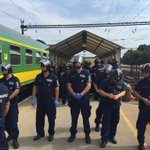 Behind the riot police 100+ refugees have been corralled. Say the wont be taken to camps. Rest held on train http://t.co/NZG9KCkkB8