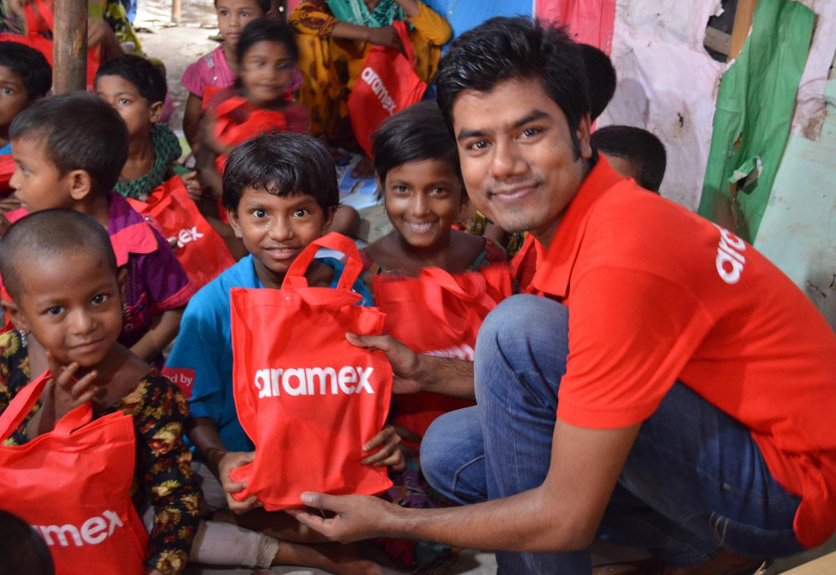 Proud of our colleagues from #Bangladesh spending some time at a primary school distributing school supplies #aramex http://t.co/eRjrq4xukg