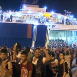 Ferry carrying thousands of migrants arrives from Lesbos http://t.co/VBar0OLgnw http://t.co/6j5Yz5WQgA