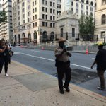 Sheriffs deputy addresses the media with megaphone outside courthouse where hearing in Freddie Gray will be held. http://t.co/3B4PLkHHXH