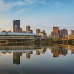 Downtown #Pittsburgh reflects in the calm Allegheny River just before sunrise in this panorama from the North Shore http://t.co/2BVPDQVJPB