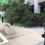 Officers line perimeter around #Baltimore PD headquarters amid #FreddieGray protests. #WTOP http://t.co/UKq9UzKkBS
