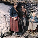 Three generations of a family outside their stone cottage, Connemara, Co. Galway in 1927 (photo Clifton R. Adams) http://t.co/71pvdcofSM