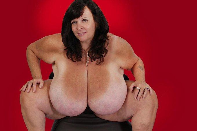 bottle between breasts
