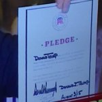 .@realDonaldTrump holding up the pledge he signed, dated August 3, 2015 http://t.co/KGIXoziXWv via @bennyjohnson