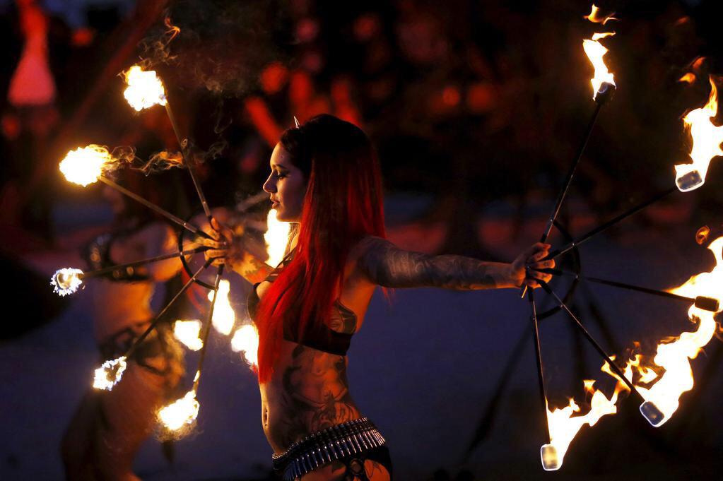 Our girl @CervenaFox performing her fire fan routine at @hellfestopenair this year! http://t.co/s7XB4m7MT0