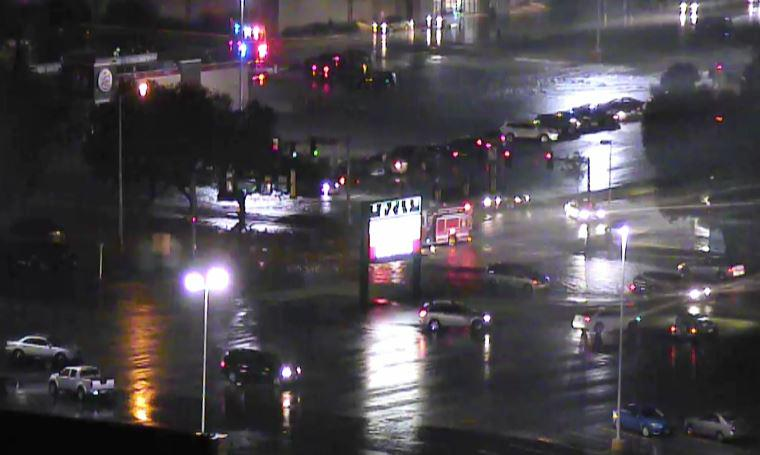 """Streets blocked near Empire Mall in Sioux Falls. 4-7"""" rainfall in under 1 hr. A boat being brought in. http://t.co/gnNz28AlOP"""