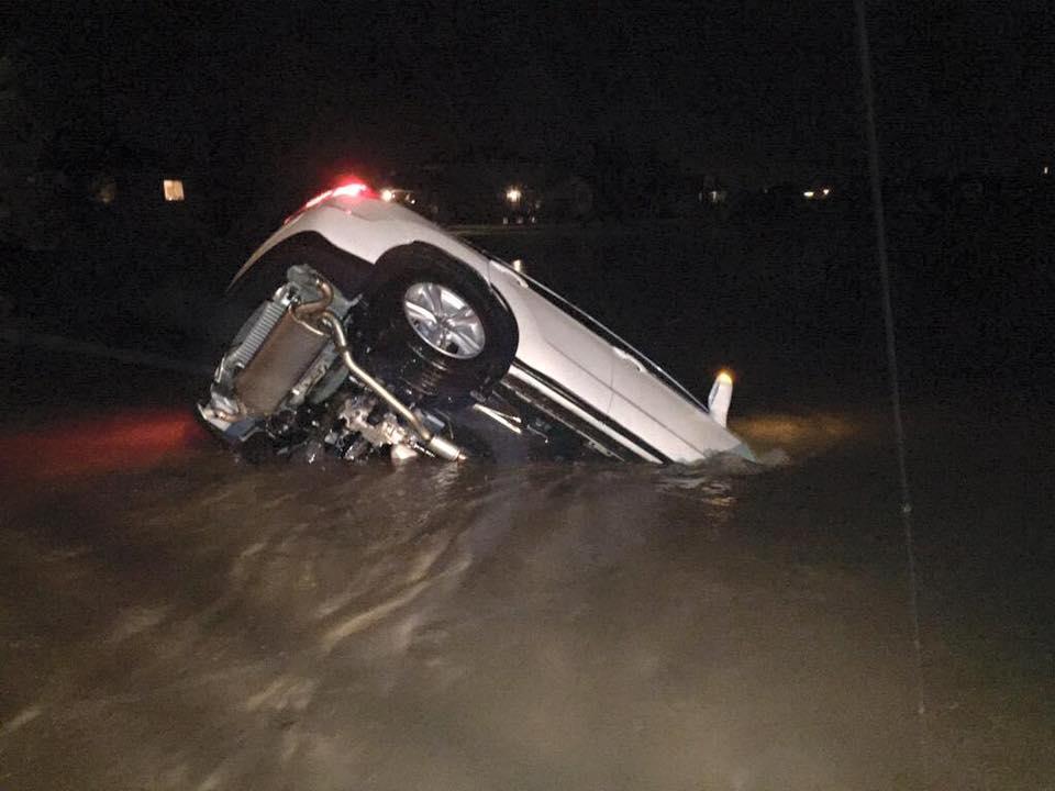 "12th Street in Sioux Falls, SD. 7-8"" rain in under an hour. Urban flash flooding. Lee Johnson photo. http://t.co/wAg6OqCG85"
